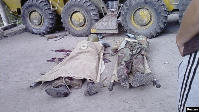 Bodies of government soldiers lie on the ground in the town of Khorog, capital of the autonomous region of Gorno-Badakhshan, in this undated handout picture received by Reuters on July 26, 2012.