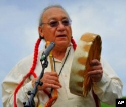 Mario Garza speaks about the census at a pow-wow in Texas.