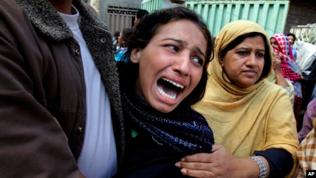 A Pakistani Christian woman mourns over a family member who was killed from a suicide bombing attack near two churches in Lahore, Pakistan, March 15, 2015.
