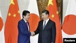 中國國家主席習近平在北京會晤到訪的日本首相安倍晉三。(2018年10月26日)