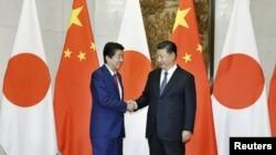 中國國家主席習近平在北京會晤到訪的日本首相安倍晉三。 (2018年10月26日)