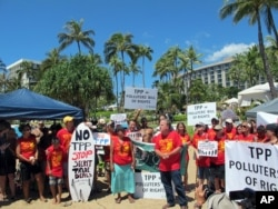 Demonstrators protest outside the Westin Maui resort in Lahaina, Hawaii, where ministers from Pacific Rim nations are gathering to negotiate a new trade pact, July 29, 2015.