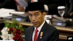 """FILE - Indonesian President Joko """"Jokowi"""" Widodo delivers his speech before Parliament members ahead of the country's Independence Day in Jakarta, Indonesia, Aug. 14, 2015."""