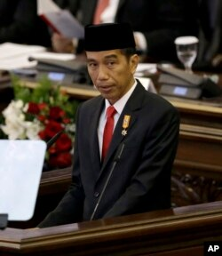 "FILE - Indonesian President Joko ""Jokowi"" Widodo delivers a speech before Parliament members ahead of the country's Independence Day in Jakarta, Indonesia, Aug. 14, 2015."