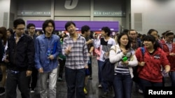 Students leave after a Scholastic Assessment Test (SAT) exam at AsiaWorld-Expo in Hong Kong November 2, 2013.