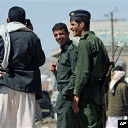 Yemeni police are seen at a checkpoint in the capital San'a, Yemen, 01 Nov 2010