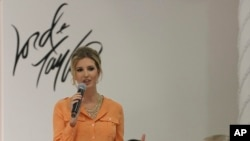 FILE - Ivanka Trump wears an outfit she designed as she speaks to the audience prior to the presentation of her Ready-To-Wear Collection at the Lord & Taylor flagship store in New York, March 28, 2012.