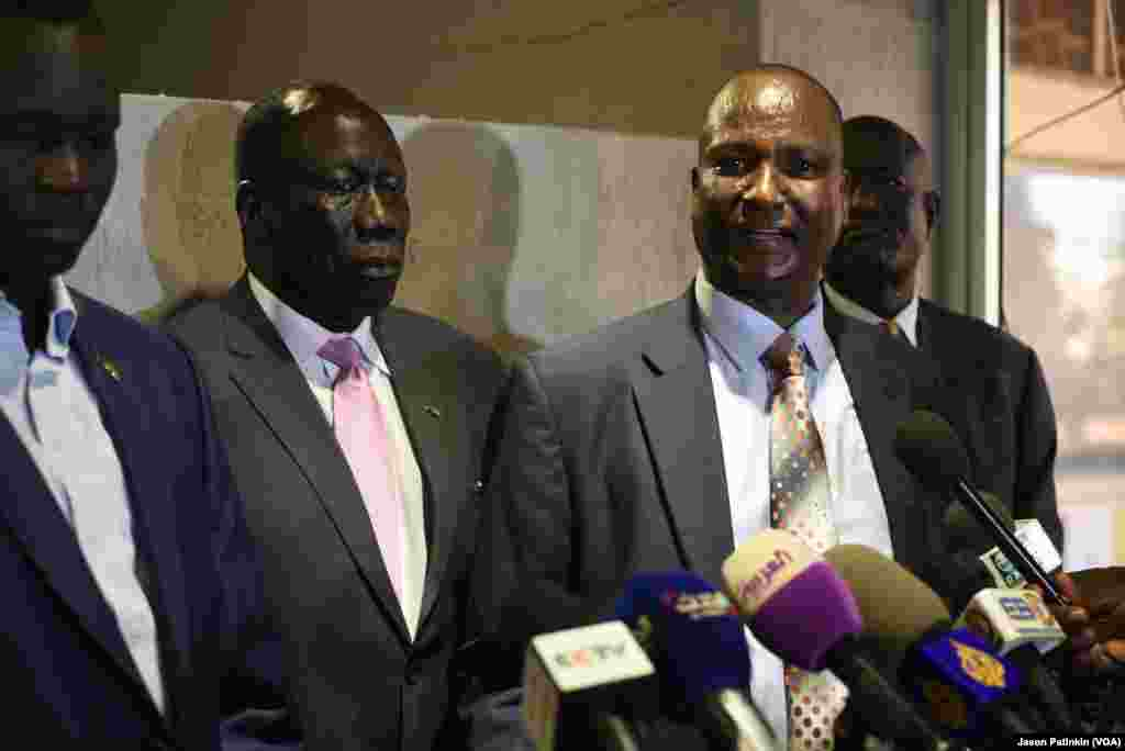 Taban Deng Gai, right, chief negotiator for South Sudan's rebels, speaks at a news conference following the arrival of the rebels' second-in-command, Alfred Lado Gore, center left, in Juba, April 12, 2016.