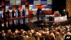 Rick Santorum, left, Chris Christie, Mike Huckabee, Bobby Jindal appear during Republican presidential debate at Milwaukee Theatre in Milwaukee, Wisconsin, Nov. 10, 2015.