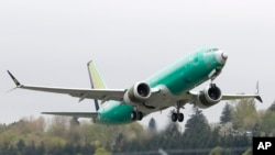 FILE - A Boeing 737 MAX 8 airplane being built for India-based Jet Airways, takes off on a test flight at Boeing Field in Seattle, April 10, 2019. A global team of experts next week will begin reviewing how the Boeing 737 Max's flight control system was approved by the FAA.