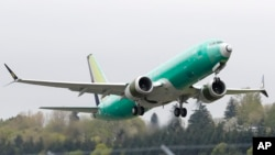 FILE - A Boeing 737 Max 8 airplane being built for India-based Jet Airways takes off on a test flight at Boeing Field in Seattle, April 10, 2019.