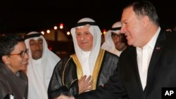 U.S. Secretary of State Mike Pompeo shakes hands with Ambassador Reem Al-Khaled, as he arrives at Kuwait International Airport in Kuwait City, Kuwait, March 19, 2019.