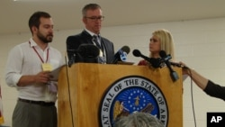 Media witnesses speak about the execution of Ledell Lee in Varner, Ark., early April 21, 2017. Lee was the first inmate put to death in Arkansas since 2005. John Moritz of the Arkansas Democrat-Gazette, from left, Sean Murphy of The Associated Press and Marine Glisovic witnessed Lee's death. The last of the scheduled executions is Thursday.