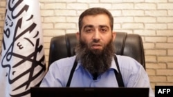 An image grab taken from a propaganda video uploaded on Sept. 9, 2013 by Syria's Islamic Front shows the new leader of Ahrar al-Sham group, Hashem al-Sheikh, known as Abu Jaber, speaking at an undisclosed location in Syria.