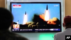 File - People watch a TV news program showing rockets launched by North Korea, at Seoul Railway Station in Seoul, South Korea, Sunday, March 23, 2014. (AP Photo/Ahn Young-joon)