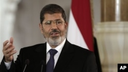 Egyptian President Mohammed Morsi, speaks with reporters in Cairo, July 13, 2012.