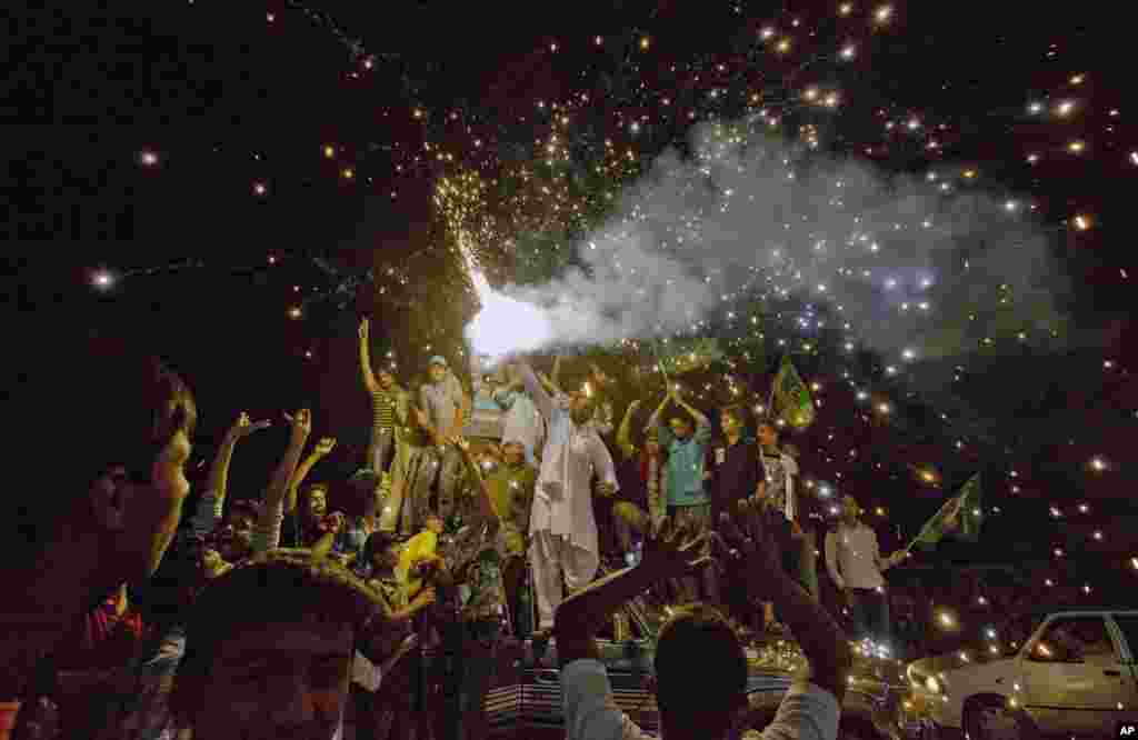 Pakistan Muslim League supporters release fireworks to celebrate after initial results gave their party the lead in parliamentary elections, Lahore, May 12, 2013.