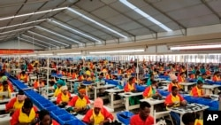 FILE - Ethiopian factory workers produce shoes at the Chinese company Huajian's plant in the Lebu Industrial complex near Addis Ababa, Ethiopia, Jan. 5, 2017.
