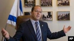 FILE - Jerusalem Mayor Nir Barkat speaks during an interview with The Associated Press in Jerusalem, Feb. 27, 2018.