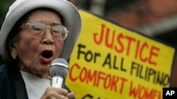 "FILE - Anastacia Cortez, 92, who says she was held as a ""comfort woman"" by the Japanese military during World War II, speaks as members of the Lila Pilipina hold a rally at the Mendiola bridge, near the Malacanang Presidential palace in Manila, Philippi"