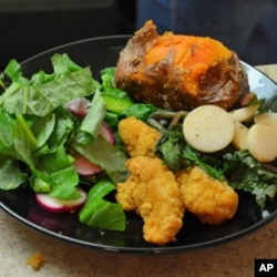 Dinner at one Maryland group home features greens and turnips, salad with radishes and peppers, and sweet potatoes - all grown at Red Wiggler Farm.