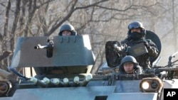 FILE - South Korean soldiers ride an armored during an annual exercise in Paju, near the border with North Korea.