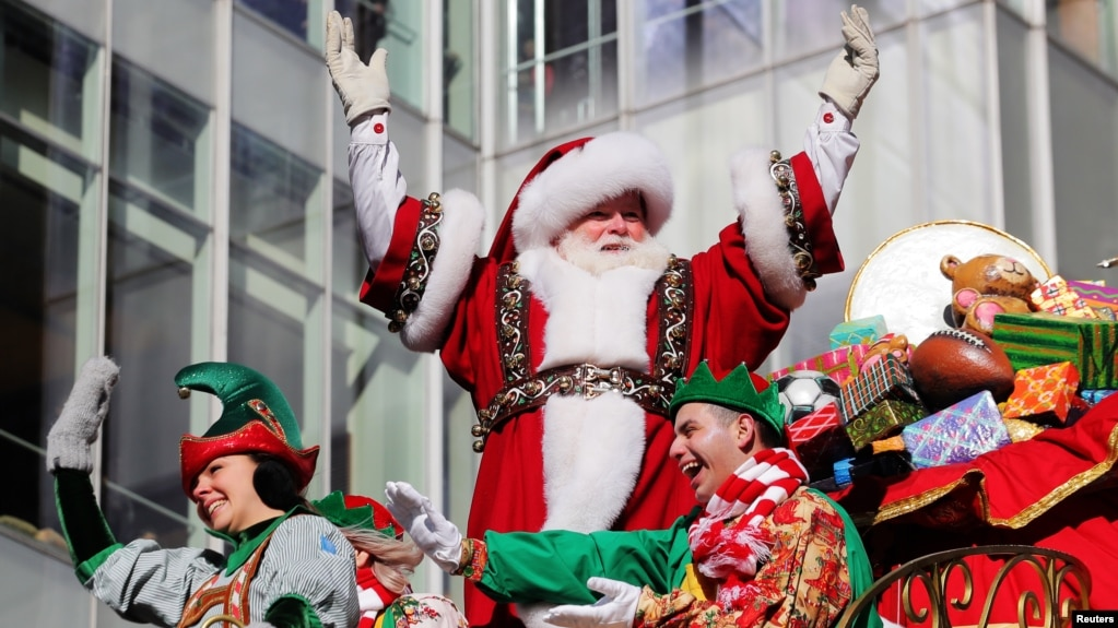Santa Claus waves to the crowd during the 92nd Macy's Thanksgiving Day Parade in Manhattan, New York, U.S., November 22, 2018.