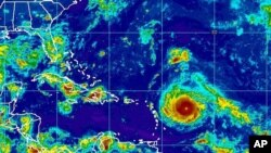 This Sept. 4, 2017, satellite image provided by the National Oceanic and Atmospheric Administration shows Hurricane Irma nearing the eastern Caribbean. Hurricane Irma grew into a powerful Category 4 storm Monday.