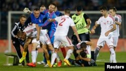 Fans, players of Serbia and Albania clash during Euro 2016 Group I qualifying soccer match, FK Partizan stadium, Belgrade, Oct. 14, 2014.