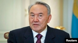 FILE - Kazakhstan's President Nursultan Nazarbayev attends a meeting at his office in Almaty, Feb. 25, 2013.