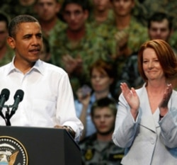 President Obama and Australian Prime Minister Julia Gillard with American and Australian troops in Darwin