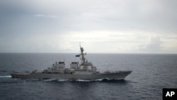 FILE - This photo provided by the U.S. Navy shows the guided-missile destroyer USS Decatur (DDG 73) operating in the South China Sea, Oct. 13, 2016.