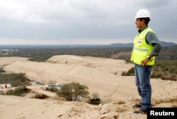 Giovanni Palacios, director and lead engineer of the Olmos Irrigation Project, watches a construction area of the project in Lambayeque, March 15, 2013.