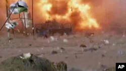 A car bomb at the moment of explosion; one in a series of bombs that exploded, April 25, 2014 at a campaign rally for a Shi'ite group in Baghdad, Iraq.