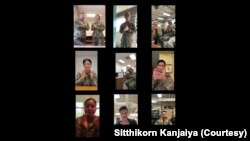 A snapshot of a clip of American-Thai military personnel clapping to support Thai medical staff.