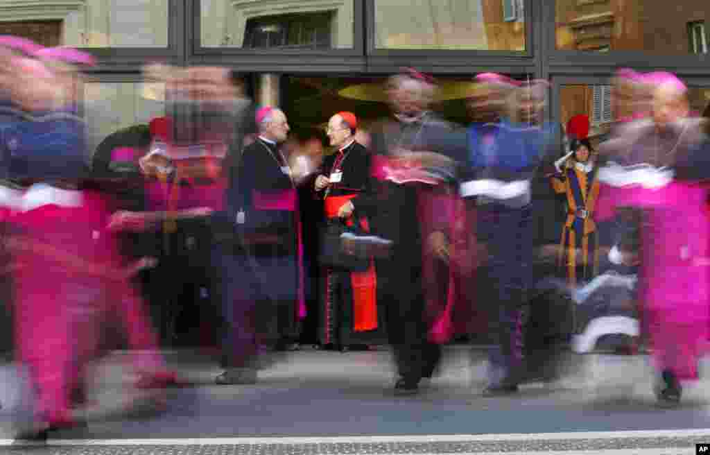 Cardinals and bishops leave at the end of a morning session of the Synod of bishops, at the Vatican in Rome.