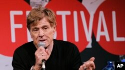FILE - Robert Redford addresses reporters in Park City, Utah, Jan. 16, 2014.