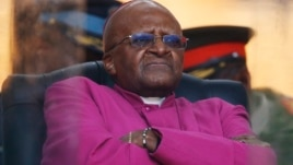 FILE - In this Dec. 10, 2013 photo, Retired Anglican Archbishop Desmond Tutu waits to speak during the memorial service for former South African president Nelson Mandela at the FNB Stadium in Soweto near Johannesburg.