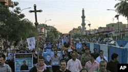Muslims and Christians chant anti-terrorist slogans during a funeral of slain Christians in Baghdad, Iraq, 02 Nov 2010.