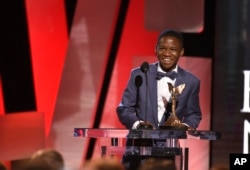 "Abraham Attah accepts the award for ""Beasts of No Nation"" at the Film Independent Spirit Awards, Feb. 27, 2016, in Santa Monica, California."