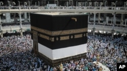 FILE - Muslim pilgrims circle the Kaaba, the cubic building built by Prophet Abraham in the holy city of Mecca, Saudi Arabia.