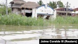 Flooding is seen in Bato, Camarines Sur, Philippines Jan. 1, 2019, in this still image from social media obtained Jan. 2, 2019.