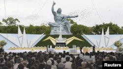 Doves fly over the Peace Statue in Nagasaki's Peace Park during a ceremony commemorating the 72nd anniversary of the bombing of the city, in Nagasaki, Japan, in this photo taken by Kyodo August 9, 2017. Mandatory credit Kyodo/via REUTERS