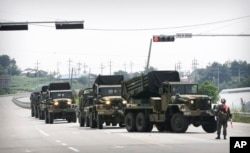 South Korean army's armored vehicles move in Yeoncheon, south of the demilitarized zone that divides the two Koreas, Aug. 22, 2015.
