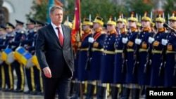 Romania's new President Klaus Iohannis walks in front of the honor guard during a take-over ceremony at Cotroceni presidential palace in Bucharest, Dec. 21, 2014.
