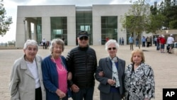 From left, Sonja Sternberg, her sister Gisela Feldman, Thomas Jacobson, Sonja Geismar, Eva Wiener passengers from the 1939 SS St. Louis trans-Atlantic ship, pose for a photograph during a visit to the Yad Vashem Holocaust memorial in Jerusalem, Nov. 17, 2016.
