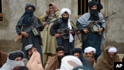 FILE - Afghan Taliban fighters are shown Nov. 3, 2015. The U.S. and Afghanistan accuse Pakistan of providing a safe haven to the Afghan Taliban.