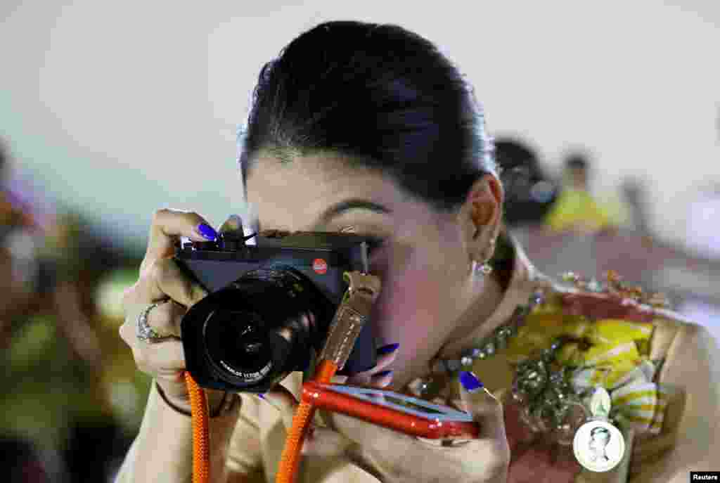 Thailand's Princess Sirivannavari Nariratana takes pictures after a religious ceremony to commemorate the death of King Chulalongkorn, known as King Rama V, at The Grand Palace in Bangkok, Thailand.