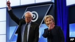 FILE - Democratic presidential candidates, Hillary Clinton and Sen. Bernie Sanders, I-Vt, stand together before the start of the Univision, Washington Post Democratic presidential debate at Miami-Dade College in Florida, March 9, 2016.