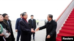 Chinese State Councilor and Foreign Minister Wang Yi welcomes Cambodian Prime Minister Hun Sen as he arrives at the Beijing Capital International Airport in Beijing, China February 5, 2020. China Daily via REUTERS ATTENTION EDITORS - THIS IMAGE WAS PROV
